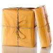 Two parcels wrapped in brown paper tied with twine arranged in stack isolat — Stock Photo