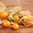 Royalty-Free Stock Photo: Physalis heap on wooden background