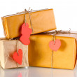Three parcels with blank heart-shaped labels isolated on white - Stok fotoğraf