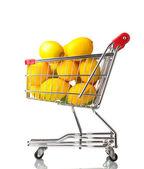 Ripe lemons in shopping cart isolated on white — Photo
