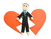 Voodoo doll boy-groom on the broken heart isolated on white — Stock Photo