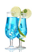 Blue cocktail in glasses with ice and sugar isolated on white — Stock Photo
