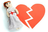 Voodoo doll girl on the broken heart isolated on white — Stock Photo