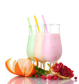 Milk shakes with fruits isolated on white — Stock Photo
