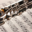 Close up detail of clarinet and notebook with notes — Stock Photo #8816907