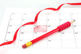 Calendar page with hearts, pencil and ribbon on St.Valentines Day — Стоковое фото