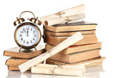 Pile of old books with clock and scroll isolated on white — ストック写真