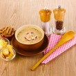 Tasty soup on wooden background — Stock Photo