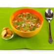 Tasty soup on green tablecloth — Stock Photo