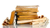 Pile of old books and scroll isolated on white — Photo