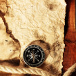 Old paper, compass and rope on a wooden table — Stockfoto