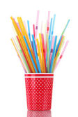 Red glass with straws isolated on white — Stock Photo