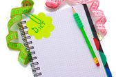 Planning of diet. Notebook measuring tapes and pen isolated on white — Stockfoto