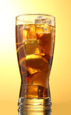 Iced tea with lemon and lime on yelow background — Stock Photo