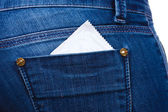 Condom in the pocket of blue jeans — Stock Photo