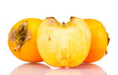 Two and half appetizing persimmons isolated on white — Stock Photo