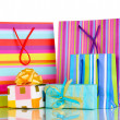 Colorful gift bags with gifts isolated on white — Stock Photo