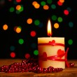Beautiful candle on wooden table on bright background — Stock Photo