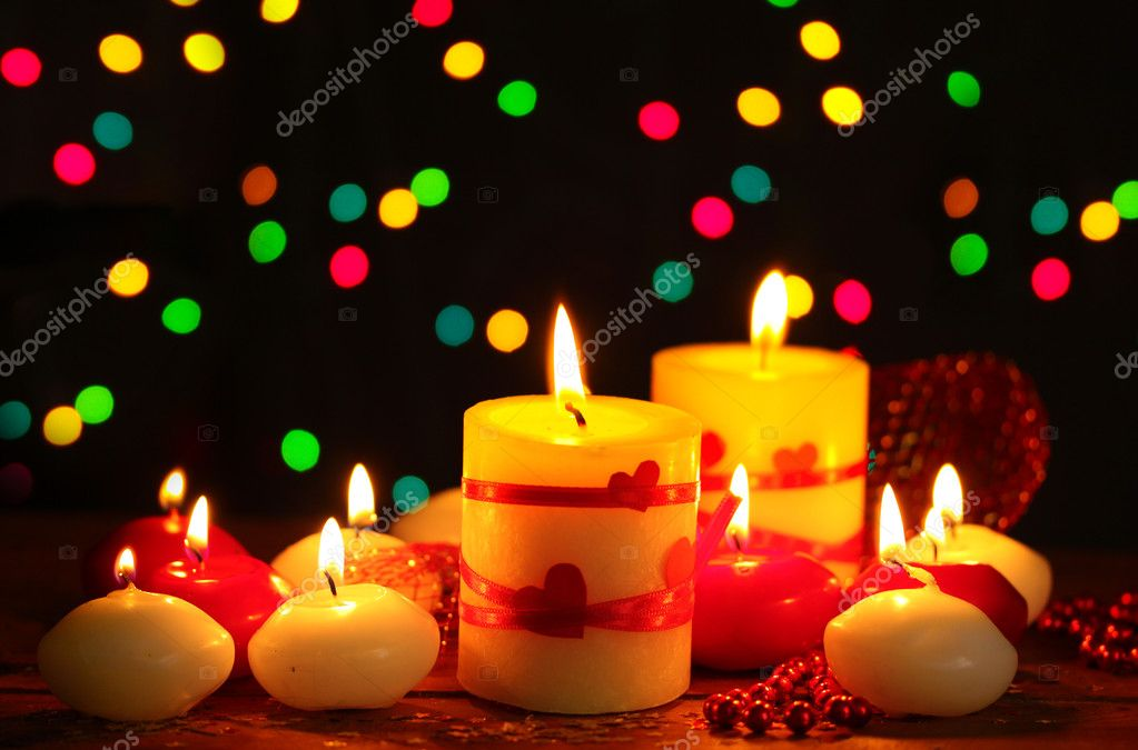 Beautiful candles on wooden table on bright background  Stock Photo #8911421