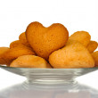 Heart-shaped cookies on glass plate isolated on white — Stock Photo