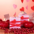 Candles for Valentine's Day on wooden table on red background — Stock Photo