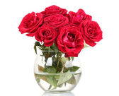Beautiful red roses in a vase isolated on white — Stock Photo