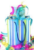 Colorful gift bags and gifts with serpentine close-up isolated on white — Stock Photo