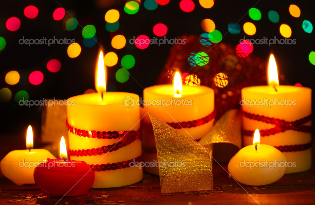 Beautiful candles on wooden table on bright background — Stock Photo #8923228