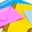 Stock Photo: Bunch of color envelopes close-up isolated on white