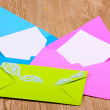 Color envelopes on wooden background — Stock Photo