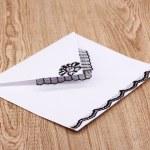 White envelope on wooden background — Stock Photo