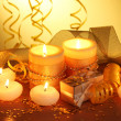 Beautiful candles, gifts and decor on wooden table on yellow background — Stock Photo #8937232