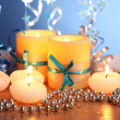 Royalty-Free Stock Photo: Beautiful candles, gifts and decor on wooden table on blue background