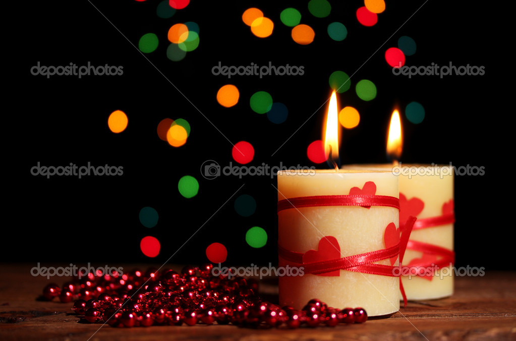 Beautiful candles on wooden table on bright background — Stock Photo #8931404