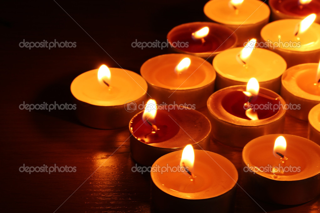 Beautiful candles and decor on wooden table  Stock Photo #8937236