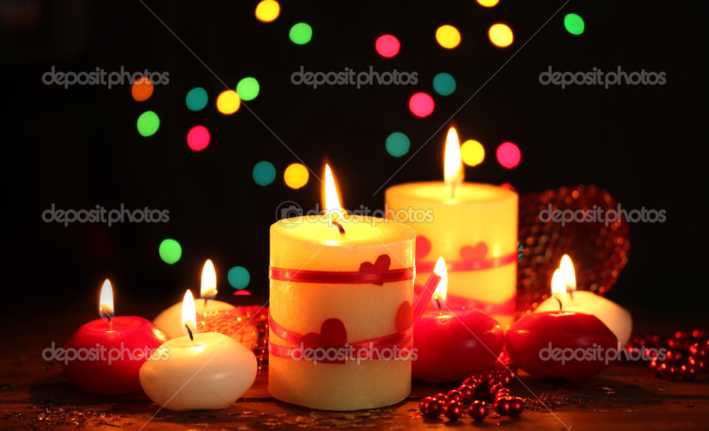Beautiful candles on wooden table on bright background  Stock Photo #8937251
