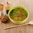 Royalty-Free Stock Photo: Tasty chicken stock with noodles on wooden background