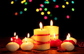 Beautiful candles on wooden table on bright background — ストック写真