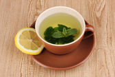 Mint tea with mint leaf and lemon on wooden background — Stock Photo