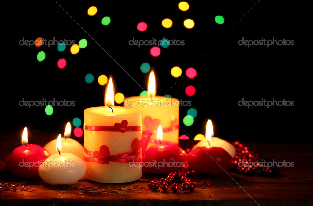 Beautiful candles on wooden table on bright background — Stock Photo #8956489