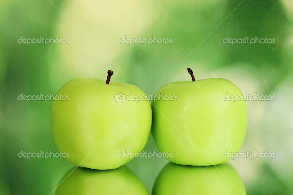 Apple candle on green background  Stock Photo #8956543