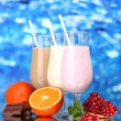 Milk shakes with fruits and chocolate on blue background — Foto Stock