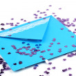 Stock Photo: Color envelope and confetti isolated on white