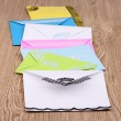 Bunch of color envelopes on wooden background — Stock Photo #8978610