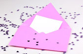 Color envelope and confetti isolated on white — Stock Photo