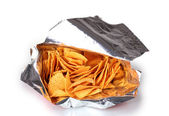 Tasty potato chips in bag isolated on white — Stock Photo