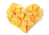 Delicious potato chips heart shape isolated on white — Stock Photo