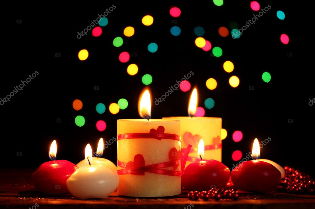 Beautiful candles on wooden table on bright background — Stock Photo #8978573