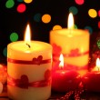 Beautiful candles on wooden table on bright background - Lizenzfreies Foto