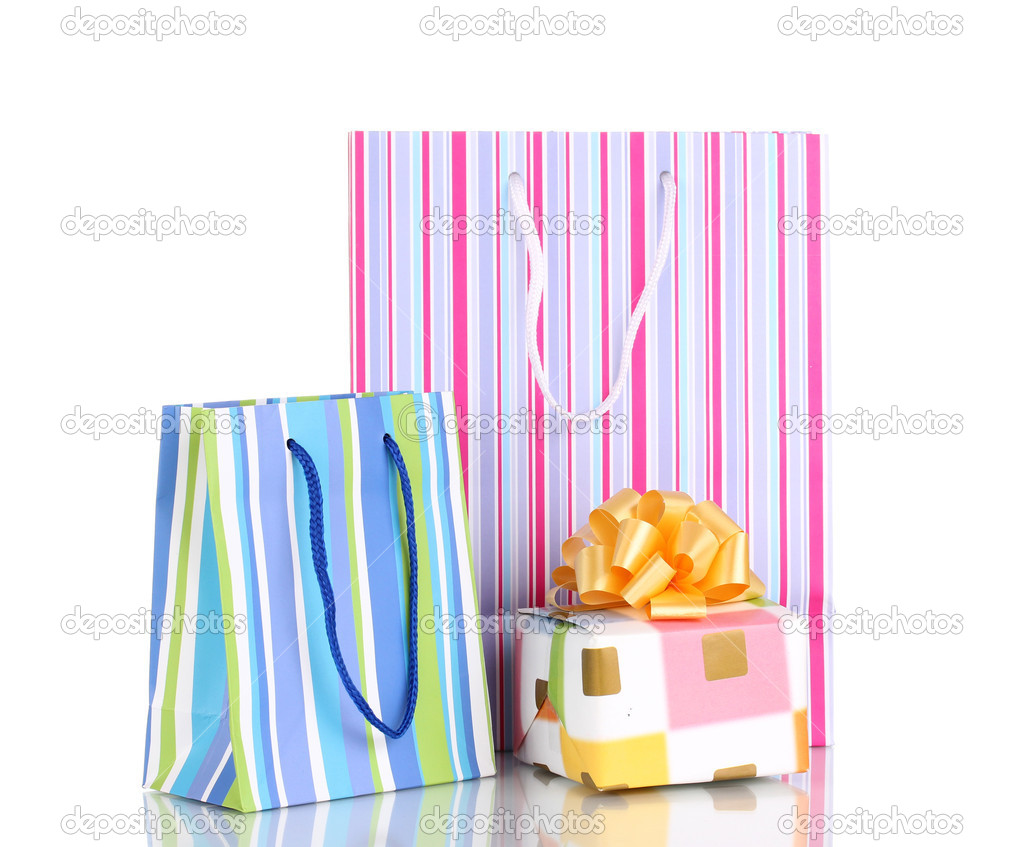 Colorful gift bags with gifts isolated on white  Stock Photo #8992283